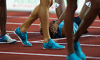 22 AUG 2013 - STOCKHOLM, SWE - Ayanleh Souleiman of Djibouti recovers after winning the men's 1500m race in a time of 3:33:59 during the DN Galen meet of the 2013 Diamond League at the Stockholm Olympic Stadium in Stockholm, Sweden (PHOTO COPYRIGHT © 2013 NIGEL FARROW, ALL RIGHTS RESERVED)