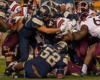 Pitt linebacker Matt Galambos (47) makes a tackle. The Virginia Tech Hokies defeated the Pitt Panthers 39-36 on October 27, 2016 at Heinz Field in Pittsburgh, Pennsylvania.