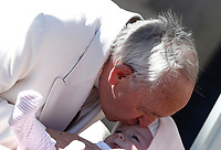 Papa Francesco bacia una bambina al suo arrivo all'udienza generale del mercoledi' in Piazza San Pietro, Citta' del Vaticano, 19 aprile, 2017.<br /> Pope Francis kisses a child as he arrives for his weekly general audience in St. Peter's Square at the Vatican, on April 19 2017.<br /> UPDATE IMAGES PRESS/Isabella Bonotto<br /> <br /> STRICTLY ONLY FOR EDITORIAL USE