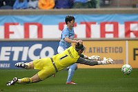 Sky Blue FC goalkeeper Karen Bardsley (1) dives in an effort to block a shot by Chicago Red Stars midfielder Megan Rapinoe (8).  The Chicago Red Stars tied Sky Blue FC 0-0 at Toyota Park in Bridgeview, IL on April 19, 2009.