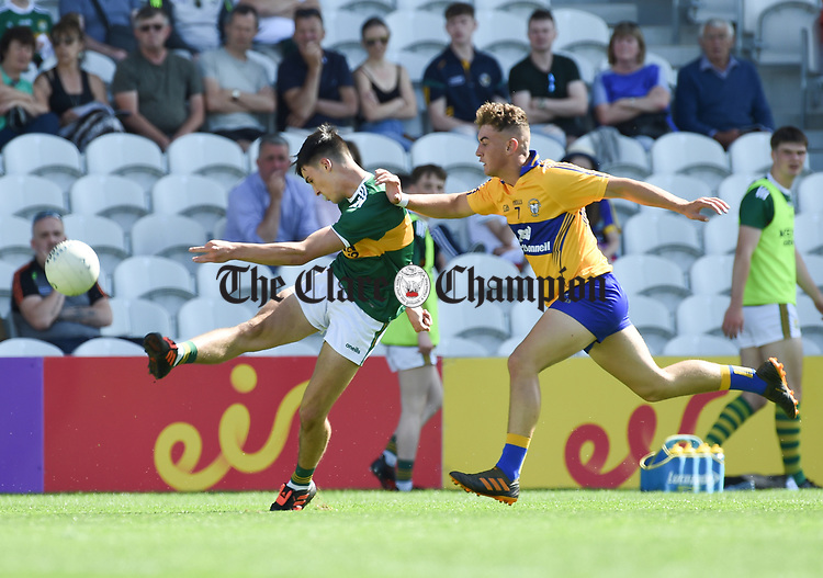 Paul O Shea of Kerry in action against Adam O'Connor of Clare during their Munster Minor football final at Pairc Ui Chaoimh. Photograph by John Kelly.