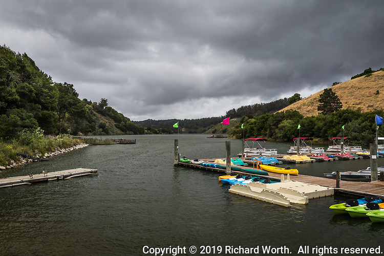 Ominous storm clouds over Lake Chabot, a water recreation site and emergency water resource, in the East Bay Hills east above San Francisco Bay.