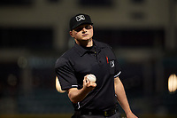Home plate umpire Lance Seilhamer during a Midwest League game between the Quad Cities River Bandits and Fort Wayne TinCaps at Parkview Field on May 3, 2019 in Fort Wayne, Indiana. Quad Cities defeated Fort Wayne 4-3. (Zachary Lucy/Four Seam Images)
