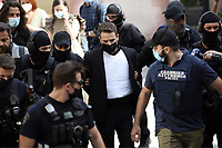 Pictured: Charalambos (Babis) Anagnostopoulos being led to a magistrate guarded by police in Athens, Greece. Friday 18 June 2021<br /> Re: Charalambos (Babis) Anagnostopoulos, the husband of Caroline Crouch, who was killed in front of her 11 month old daughter is due to appear before a Magistrate, charged with her murder at their home in Glyka Nera, near Athens, Greece.<br /> The woman, 20, was allegedly first tortured and then strangled to death.