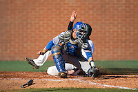 Louisiana Tech Bulldogs catcher Brent Diaz (18) fields a throw as Nick Daddio (20) of the Charlotte 49ers slides across home plate at Hayes Stadium on March 28, 2015 in Charlotte, North Carolina.  The 49ers defeated the Bulldogs 9-5 in game two of a double header.  (Brian Westerholt/Four Seam Images)