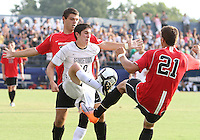 Andy Riemer #20 of Georgetown University kicks the ball away from Josh Semerene #21 of Northeastern University during an NCAA match at North Kehoe Field, Georgetown University on September 3 2010 in Washington D.C. Georgetown won 2-1 AET.