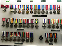 BNPS.co.uk (01202 558833)<br /> Pic: SusanBond/BNPS<br /> <br /> Gen Henry Curtis DSO, MC (top row) and Brig Peter Curtis MC (bottom left) on display at the Museum before the controversy broke - these medals are fakes.<br /> <br /> Military museum in hot water over missing medals..<br /> <br /> A woman whose father and grandfather donated their highly-valuable gallantry medals to an army museum is furious they have disappeared having been suspiciously substituted for duplicates.<br /> <br /> Susan Bond, whose husband Richard is a retired crown court judge, discovered the two Military Cross groups at the The Royal Green Jackets Museum are not the ones bequeathed to them after one set appeared on the open market.<br /> <br /> Mrs Bond confronted the trustees at the museum, whose former Colonel-in-Chief was the Queen, but the 70-year-old has been left dismayed at their 'indifferent' response at the loss which they have been unable to properly explain.<br /> <br /> The owners - the museum based in Winchester, Hants - said they were satisfied that no criminal activity had taken place and the police investigation came to nothing.