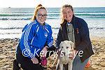 Enjoying a stroll in Banna beach on Monday, l to r: Katie O'Riordan and Aoife Fitzgerald with Fia the dog.