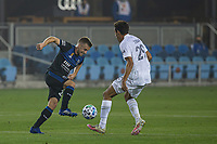 SAN JOSE, CA - SEPTEMBER 13: Tommy Thompson #22 of the San Jose Earthquakes goes by Ethan Zubak #29 of the L.A. Galaxy during a game between Los Angeles Galaxy and San Jose Earthquakes at Earthquakes Stadium on September 13, 2020 in San Jose, California.
