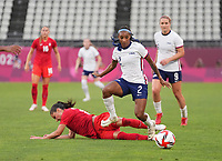 KASHIMA, JAPAN - AUGUST 2: Crystal Dunn #2 of the United States with the ball during a game between Canada and USWNT at Kashima Soccer Stadium on August 2, 2021 in Kashima, Japan.
