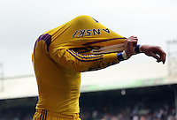 Pictured: Swansea goalkeeper Lukasz Fabianski trhows his gloves and shirt to away supporters<br /> Re: Premier League match between Crystal Palace and Swansea City at Selhurst Park on May 24, 2015 in London, England, UK