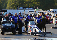 Aug 15, 2014; Brainerd, MN, USA; Crew members wait with NHRA top fuel dragster driver Morgan Lucas during qualifying for the Lucas Oil Nationals at Brainerd International Raceway. Mandatory Credit: Mark J. Rebilas-