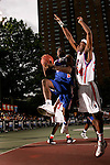 Tyreke Evans (1) drives to the basket with defense by Donte Greene (34) during the Elite 24 Hoops Classic game on September 1, 2006 held at Rucker Park in New York, New York.  The game brought together the top 24 high school basketball players in the country regardless of class or sneaker affiliation.
