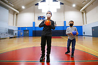 Jordin Lewandowski, 9, gets ready to play in the gymnasium with his classmates at the Boys and Girls Club of Western Pennsylvania in the Lawrenceville neighborhood on Friday February 19, 2021 in Pittsburgh, Pennsylvania. (Photo by Jared Wickerham/Pittsburgh City Paper)
