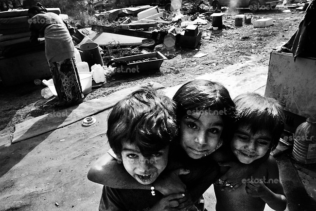 SERBIA, Belgrade, Oct. 15, 2006..Gypsy kids play in front of their home located in an isolated ghetto-like settlement on outskirts of Belgrade, Serbia, Monday, Oct. 15, 2006. The Smaili family fled Kosovo in 1999 and are now living in a ghetto among 36 other families without electricity or water. The status of the Serbian southern province still remains unresolved while Serbia is woating on a public referendum for new Serbian constitution. © Djordje Jovanovic/EST&OST