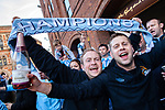 © Joel Goodman - 07973 332324 . 13/05/2012 .  Manchester , UK . Manchester City Football Club fans celebrate in Manchester City Centre after MCFC wins the Premiership title . Photo credit: Joel Goodman
