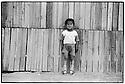 Uzbekistan - Muynak - A little boy standing in the street.
