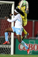 Chicago's Danesha Adams (9) collides with Sky Blue goalkeeper Jenni Branam (23).  Sky Blue defeated the Chicago Red Stars 1-0 in a mid-week game, Wednesday, June 17, at Yurcak Field.
