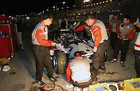 .The Archangel crew  works to repair their #21 SRP II car, damaged when Larry Oberto spun in turn one and struck by the #67 Racer's Group Porsche...