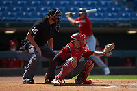 Catcher Jacob Cozart (14) of Wesleyan Christian Academy in High Point, NC playing for the Arizona Diamondbacks scout team sets a target as home plate umpire Lance Weems looks on during the East Coast Pro Showcase at the Hoover Met Complex on August 4, 2020 in Hoover, AL. (Brian Westerholt/Four Seam Images)