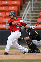 Cristian Santana #18 of the Hickory Crawdads follows through on his swing versus the West Virginia Power at L.P. Frans Stadium June 21, 2009 in Hickory, North Carolina. (Photo by Brian Westerholt / Four Seam Images)