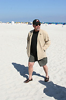 MIAMI BEACH,  FL. JANUARY 7, 2005: Piano man Billy Joel takes a stroll in front of the Delano Hotel in Miami Beach.  January 07, 2006 in Miami Beach, Florida. <br />  <br /> People; Billy Joel