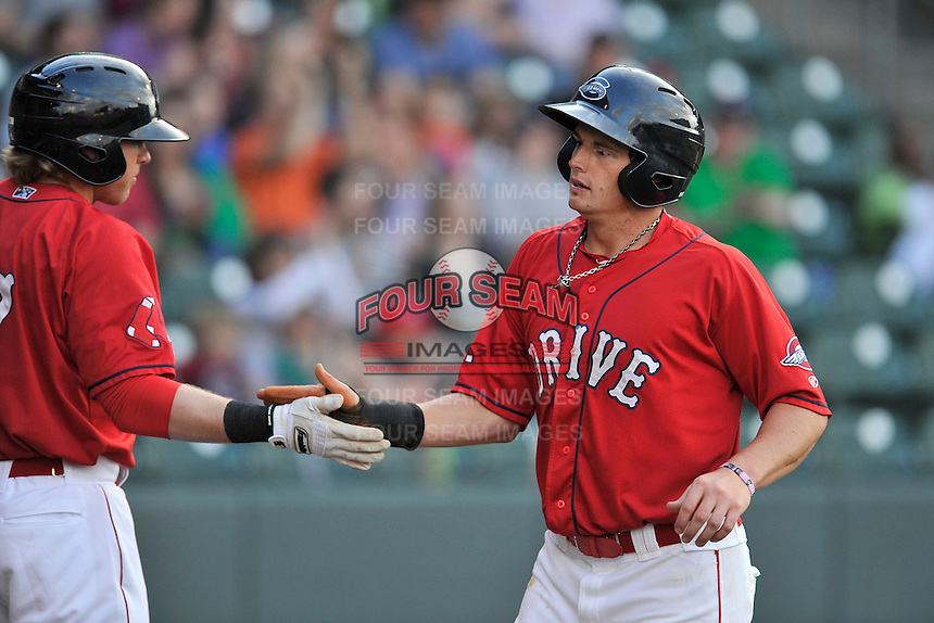 Center fielder Tate Matheny (16) of the Greenville Drive is congratulated after scoring in a game against the Columbia Fireflies on Friday, April 22, 2016, at Fluor Field at the West End in Greenville, South Carolina. Columbia won, 5-3. (Tom Priddy/Four Seam Images)