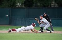 STANFORD, CA - April 19, 2013: Stanford center fielder Wayne Taylor (7) sliding back into first base during the Stanford vs Arizona baseball game at Sunken Diamond in Stanford, California. Final score, Stanford 4, Arizona 3.