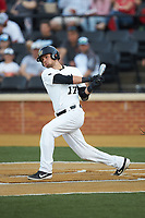Bruce Steel (17) of the Wake Forest Demon Deacons follows through on his swing against the North Carolina State Wolfpack at David F. Couch Ballpark on April 18, 2019 in  Winston-Salem, North Carolina. The Demon Deacons defeated the Wolfpack 7-3. (Brian Westerholt/Four Seam Images)