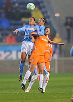 Sky Blue FC player Megan Schnur and Red Stars player Jill Oakes  both leap for the ball during their game. Sky Blue FC tied Chicago Red Stars 0-0 on April 19, 2009.