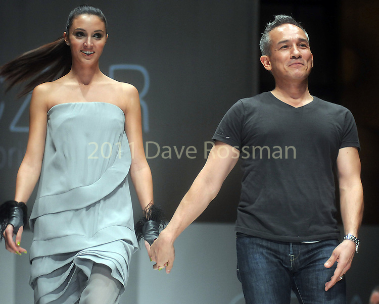 Designer Cesar Galindo with model Katelyn Denney after his  show at the second night of Fashion Houston at the Wortham Theater Monday Oct. 10,2011.(Dave Rossman/For the Chronicle)