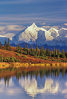 Autumn landscape of mount Brooks reflecting in Wonder Lake, Alaska Range, Denali National Park, Alaska.