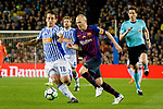 Andres Iniesta of FC Barcelona (R) fights for the ball with Mikel Oyarzabal of Real Sociedad (L) during the La Liga match between Barcelona and Real Sociedad at Camp Nou on May 20, 2018 in Barcelona, Spain. Photo by Vicens Gimenez / Power Sport Images