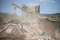 Dust comes out of a collapsing house during the second earthquake shock that hit Nepal.  Shanku, outside Kathmandu, Nepal. May 12, 2015