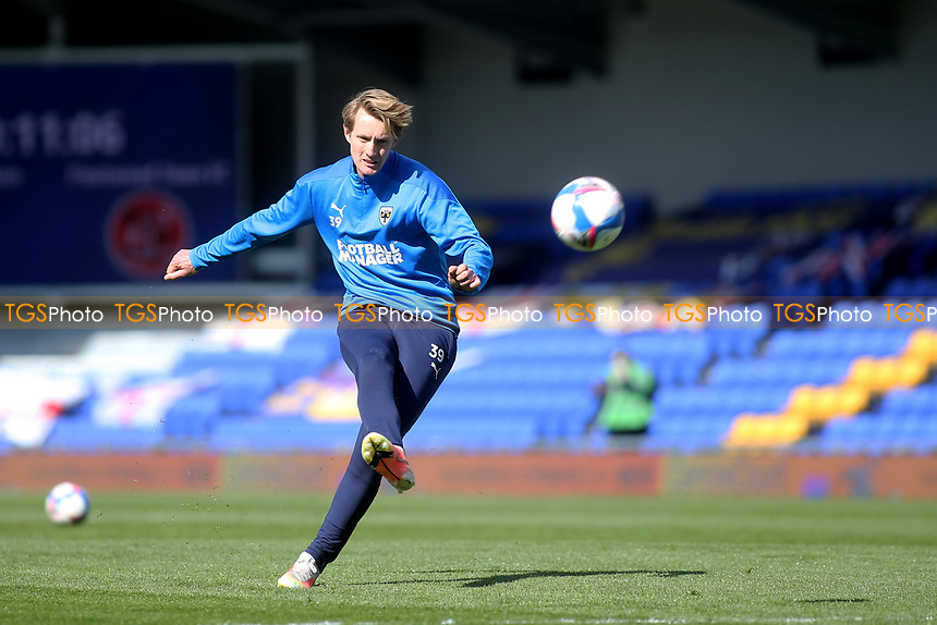 Joe Pigott of AFC Wimbledon warms up ahead of kick-off during AFC Wimbledon vs Fleetwood Town, Sky Bet EFL League 1 Football at Plough Lane on 5th April 2021