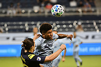 KANSAS CITY, KS - OCTOBER 11: Jaylin Lindsey #26 of Sporting Kansas City wins the aerial dual with Alex Muyl #29 of Nashville SC during a game between Nashville SC and Sporting Kansas City at Children's Mercy Park on October 11, 2020 in Kansas City, Kansas.
