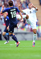 August 07, 2012..Mexico's Marco Fabian and Japan's Keigo Higashi in action during Semi Final match at the Wembley Stadium on day eleven in Wembley, England. Mexico defeat Japan 3-1 to reach Men's Finals of the 2012 London Olympics...