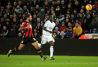 Eder of Swansea (R) chases the ball, marked by Steve Cook of Bournemouth (L) during the Barclays Premier League match between Swansea City and Bournemouth at the Liberty Stadium, Swansea on November 21 2015
