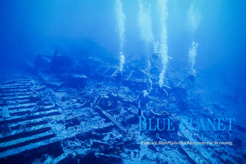 scuba divers explores wreck near stern of RMS Rhone, British Virgin Islands, Caribbean, Atlantic Ocean