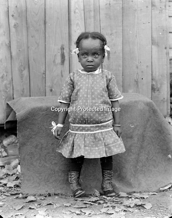 ORVELLA CLEOTA BANKS. Tiny Orvella Banks (1913-1949) went on to big things with big bands. By age four, Banks played piano. She performed on KFAB radio as a teenager. As with many African American youth, she had educational opportunities in Lincoln, first with a private piano teacher and then at Hampton School of Music, but discrimination limited her employment opportunities. Denied enrollment in Lincoln's musicians' union, she joined up in Minneapolis, then played with Harlan Leonard's big band in Kansas City.<br /> <br /> Photographs taken on black and white glass negatives by African American photographer(s) John Johnson and Earl McWilliams from 1910 to 1925 in Lincoln, Nebraska. Douglas Keister has 280 5x7 glass negatives taken by these photographers. Larger scans available on request.