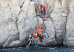 East Fork Fire and Douglas County Search and Rescue personnel rescue two swimmers Wednesday afternoon, July 20, 2011, off a 50-foot cliff near the Power Dam in Gardnerville, Nev. .Photo by Cathleen Allison