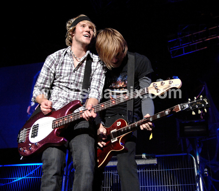 **ALL ROUND PICTURES FROM SOLARPIX.COM**.**WORLDWIDE SYNDICATION RIGHTS**.McFly perform live in concert at the Liverpool Echo Arena, Liverpool, UK. 29th November 2008..This pic: Dougie Poynter and Tom Fletcher from McFly..JOB REF: 8041 SGD     DATE: 29_11_2008.**MUST CREDIT SOLARPIX.COM OR DOUBLE FEE WILL BE CHARGED* *UNDER NO CIRCUMSTANCES IS THIS IMAGE TO BE REPRODUCED FOR ANY ONLINE EDITION WITHOUT PRIOR PERMISSION*