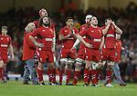 Wales forwards Adam Jones, Luke Charteris, Taulupe Faletau, Jake Ball, Gethin Jenkins and Sam Warburton wait for the decision on the big screen.<br /> RBS 6 Nations 2014<br /> Wales v France<br /> Millennium Stadium<br /> 21.02.14<br /> <br /> ©Steve Pope-SPORTINGWALES