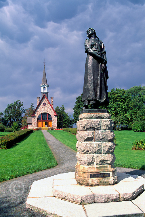 Grand Pre National Historic Site (NHS) and UNESCO World Heritage Site, Grand-Pre, NS, Nova Scotia, Canada - Statue of Evangeline (sculptor: Philippe Hébert) and Acadian Memorial Church (built 1922) on Evangeline Trail