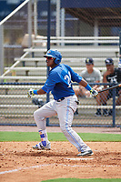 GCL Blue Jays first baseman Joseph Reyes (24) follows through on a swing during the first game of a doubleheader against the GCL Yankees East on July 24, 2017 at the Yankees Minor League Complex in Tampa, Florida.  GCL Blue Jays defeated the GCL Yankees East 6-3 in a game that originally started on July 8th.  (Mike Janes/Four Seam Images)