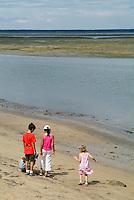 Four children on the beach at Arcachon Bay, Aquitaine, France.