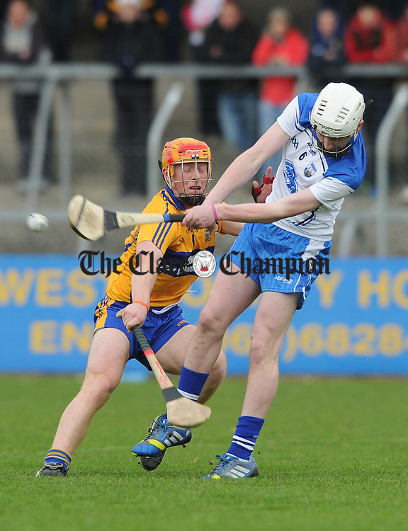 Michael O Shea of Clare in action against Shane Bennett of Waterford during their Munster Minor hurling Championship game at Cusack park. Photograph by John Kelly.