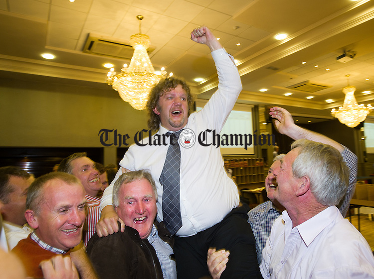 Fianna Fail's Alan O Callaghan is hoisted on high by his supporters following his election at the election count at The West county Hotel, Ennis. Photograph by John Kelly.