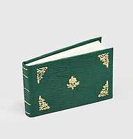 BNPS.co.uk (01202) 558833<br /> Pic: PeterHarrington/BNPS<br /> <br /> A unique miniature Harry Potter book created by JK Rowling has emerged for sale for £125,000.<br /> <br /> The author hand-wrote and illustrated the 31 page green leather bound manuscript measuring just 1.5ins by 2.5ins for a charity auction in 2004.<br /> <br /> It contains the passage on pages 52-53 of Harry Potter and The Philosopher's Stone where Harry and Hagrid go to London to buy school supplies for Hogwarts.<br /> <br /> Rowling has done original drawings of equipment including quills, scales, a cauldron and a wizard's hat.