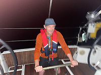 BNPS.co.uk (01202 558833)<br /> Pic: AlanBruce/BNPS<br /> <br /> Video download link: https://we.tl/t-ZBhixDUFTt.<br /> <br /> Pictured: Alan Bruce's crewmate Stephen Peare, 49, at the helm.<br /> <br /> A British sailor described his terrifying ordeal with a pack of killer whales which tried to topple his boat near the coast of Spain.<br /> <br /> Alan Bruce, 63, was sailing a Jeanneau 479 boat from Gibraltar to Cape St. Vincent, Portugal, when a large black shadow slipped beneath it.<br /> <br /> Suddenly he felt a violent thud and looked back to see a gigantic orca turning to follow him.